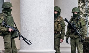 Armed military officers in camouflage outside the Simferopol airport
