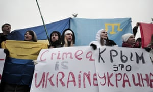 "Demonstrators in Independence Square in Kiev hold placards, ""Crimea is Ukraine"" during a rally  on Saturday."