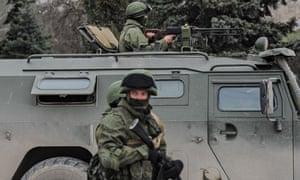 Troops in Russian military vehicles in Sevastopol in Crimea