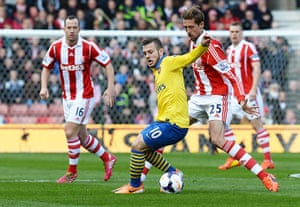 Roundup: Jack Wilshire shields the ball from Peter Crouch