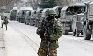 Armed servicemen Russian army vehicles Crimea