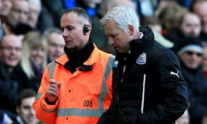 Alan Pardew is lead away from the touchline at the KC Stadium after headbutting David Meyler.