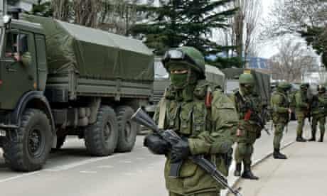 Armed Russian troops wait in convoy