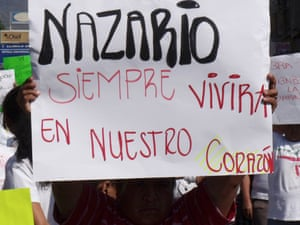 """Supporters of cartel boss Nazario Moreno after he was reported killed in 2010. The banner says """"Nazario will always live in our hearts."""" Officials believe he has now died in a gun battle."""