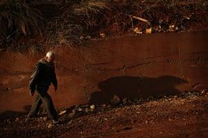Qabaait, Northern Lebanon: Khoder Osman walks at dusk