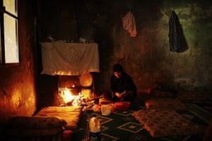 Qabaait, Northern Lebanon: A woman prepares food