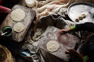 Qabaait, Northern Lebanon: A woman prepares bread
