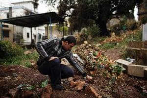 Qabaait, Northern Lebanon: A man visiting a grave
