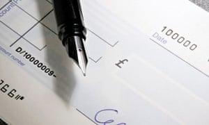 A chequebook and pen