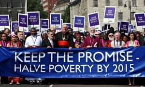 Dr Rowan Williams leads a march against poverty