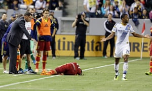 MLS replacement referees were tested on opening day. Here Real Salt Lake's Javier Morales lies near head coach Jeff Cassar as LA Galaxy's James Riley gestures his innocence.