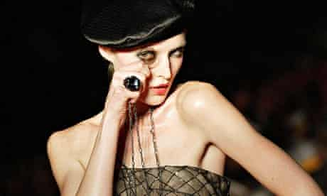 A model on the catwalk with a monocle in ParisP
