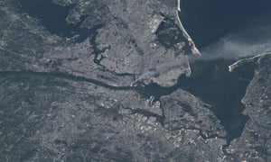 The 9/11 attack seen from space, showing smoke drifting out over New York
