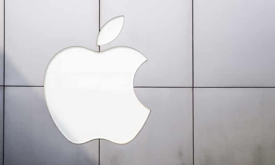 The Apple logo looms large.