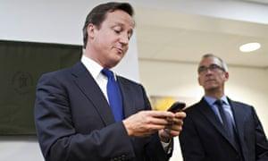 David Cameron using a mobile phone