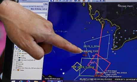 A map of MH370's flight plan is seen on computer screen