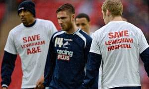 Millwall players in t-shirts supporting Lewisham hospital