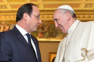 French President Francois Hollande, left, meets with Pope Francis on the occasion of their private audience at the Vatican, January 24, 2014. Hollande met Friday with Pope Francis amid tensions in his private life over a gossip magazine's report about an alleged affair with an actress.