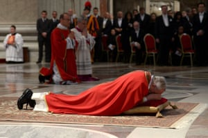 Pope Francis on ground during the Lord's Passion on Good Friday at St Peter's basilica at the Vatican.