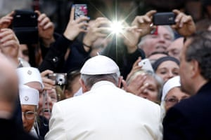 A group of nuns and others use their mobile phones to take an image of Pope Francis at the end of the Immaculate Conception celebration prayer on the Spanish Square in downtown Rome, Italy, 08 December 2013.