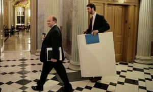 Delaware Senator Chris Coons walks with a staff member on his way to join Senate Democrats speaking nonstop on the chamber floor about climate change.