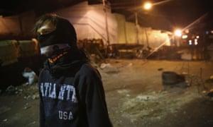 A protester mans a barricade in San Cristobal, Venezuela.