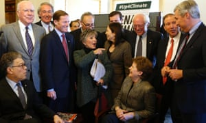 Senators gather before holding the Senate floor to urge action on climate change.