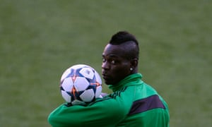 AC Milan's forward Mario Balotelli takes part in a training session at the Vicente Calderon stadium in Madrid on the eve of Milan's  Champions League quarter-finals second leg match against Atletico de Madrid.