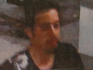 A still photo shows a man whom police said was one of the two men travelling on stolen passports onboard the missing Malaysia Airlines MH370 plane, taken before his departure at Kuala Lumpur International Airport.