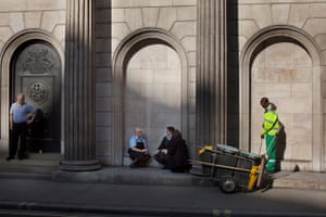 Big Picture: Square Mile: London's square mile, workers by a stone wall
