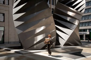 Big Picture: Square Mile: London's square mile. Woman carrying box in front of steel architecture