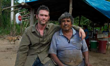 Charlie Hamilton James with gold miner Erasmus