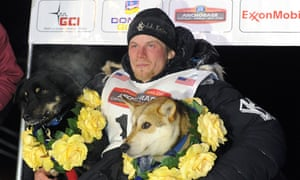 Dallas Seavey sits under the burled arch in Nome, Alaska after winning the 2014 Iditarod Trail Sled Dog Race, Tuesday, March 11, 2014.