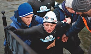 Davina McCall being helped out of Windermere after Sport Relief swim