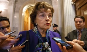 Senator Dianne Feinstein speaks to reporters after accusing the CIA of cover-up and criminal activity in a speech on the Senate floor.