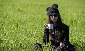 A protester enjoys a cup of tea in the sunshine. Fracking protesters have won a late legal bid to avoid eviction from a camp near a test drilling site in Salford, their lawyers said.