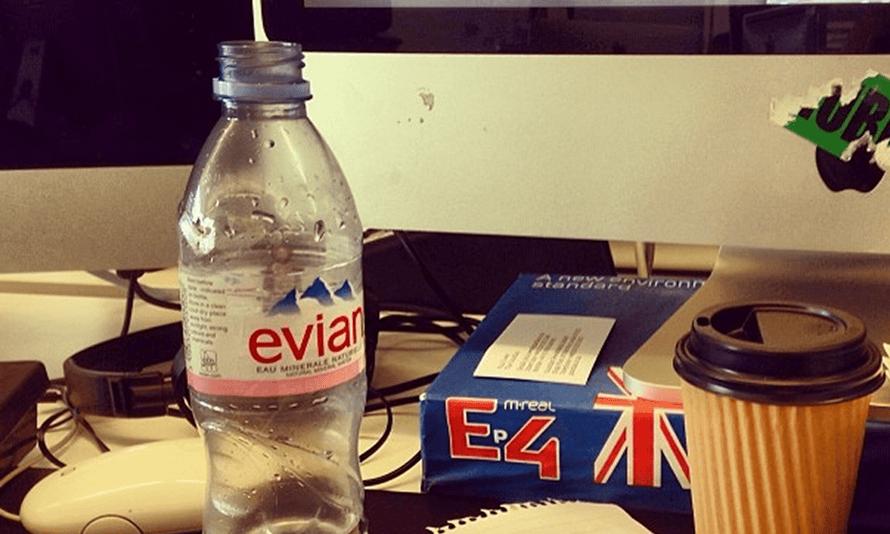 Evian bottle on desk