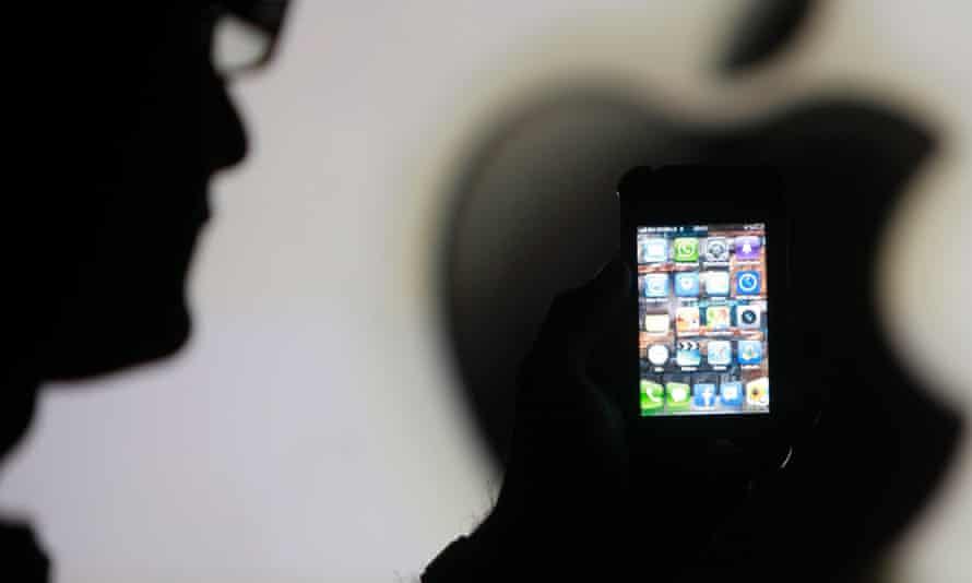 iPhone on Apple logo silhouette