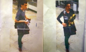 A Malaysian police official displays photographs of the two men who boarded the Malaysia Airlines MH370 flight using stolen European passports to the media at a hotel near Kuala Lumpur.