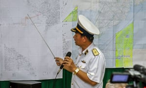 Vietnamese Navy's Deputy Commander Rear Admiral Le Minh Thanh (R) points at a map to show the area where Vietnam is conducting search activities for the missing Malaysia Airlines flight 370 in Phu Quoc island on March 12, 2014. Vietnam said on March 12 it had suspended its air search for missing flight MH370 and scaled back a sea search as it waited for Malaysia to clarify the potential new direction of the multi-national hunt.        AFP PHOTO / LE QUANG NHATLE QUANG NHAT/AFP/Getty Images