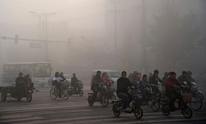 Residents ride bicycles amid heavy pollution in Xingtai, China