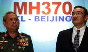 Malaysia's acting Transport Minister Hishammuddin Hussein listens to questions next to Chief of Armed Forces General Zulkifeli Mohd.