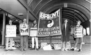 A small scale demonstration by Brent AA Group supporters in 1987, with their local MP Ken Livingstone, urging shoppers to boycott South African goods sold by Tesco.