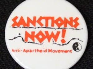 A button badge urging sanctions.