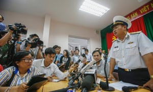Admiral Le Minh Thanh, Deputy Commander of Vietnamese Navy speaks about their mission to find the missing Malaysia Airlines flight MH370 during a news conference at Phu Quoc Airport in Phu Quoc Island.  Vietnam briefly scaled down search operations in waters off its southern coast, saying it was receiving scanty and confusing information from Malaysia over where the aircraft may have headed after it lost contact with air traffic control.