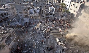 Palestinians survey the damage after an Israeli missile strike in a Gaza refugee camp in 2009.