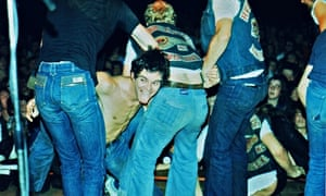 Burnel is dragged back on stage by Hells Angels during a 1977 concert in Bracknell.