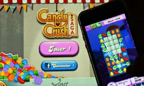 Candy Crush Saga being played on an iPhone