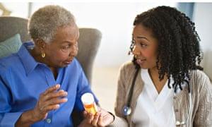 Nurse explains medication to woman