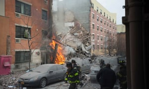 Firefighters work the scene of an explosion that destroyed two apartment buildings in the East Harlem neighborhood of New York.
